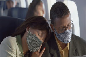 couples with mask in-flight