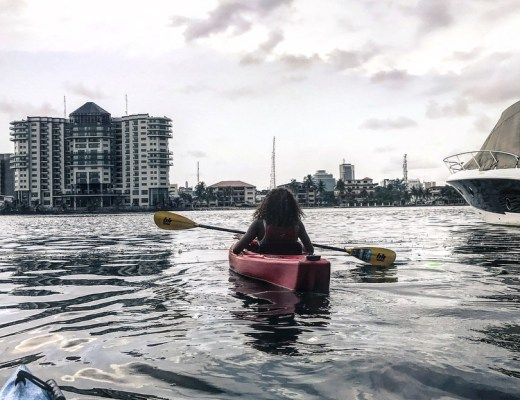 lady paddling a kayak in lagos lagoon