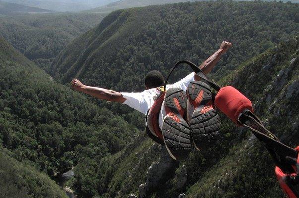 a man jumping off bloukran bridge