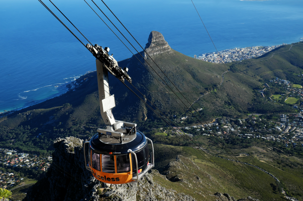 a cable car gliding towards table mountain