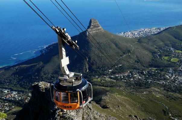 a cable car gliding towards table mountain