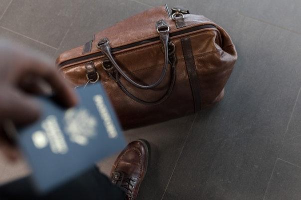 luggage by a man's feet