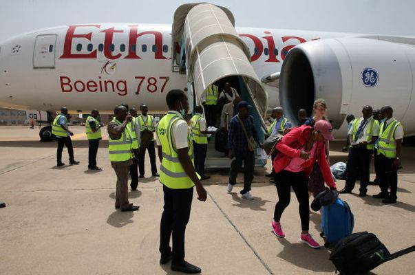 Passengers alighting from Ethiopian airplane