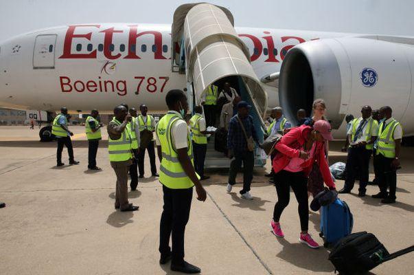 Passengers alighting from Ethiopian airplane