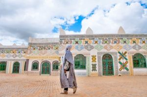 A man in the Emir of Kano's courtyard
