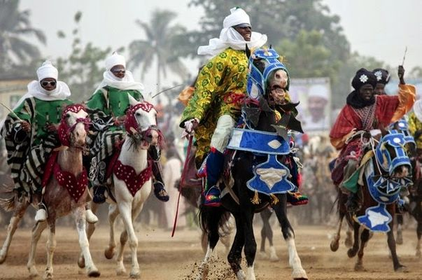 Men on horseback dressed in the native Kano attire
